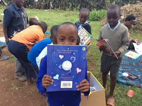 kids receive their books in Kenya